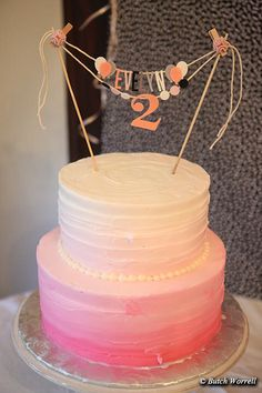 2 tier pink ombré cake, chocolate top tier and white bottom layer