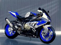 """BMW S1000RR HP4, which is a limited edition version of the """"normal"""" S1000RR and comes with upgraded exhaust and electronic suspension that adjusts to road conditions within split seconds. Probably the most competent sport motorcycle one can purchase for its model year."""