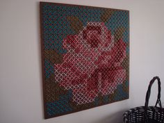 Cross stitch rose on peg board - minimal time for a big statement