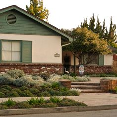Front yard with brick steps and plantings