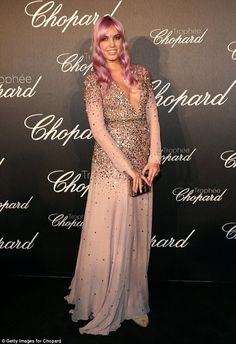 All that glitters: British model Amber Le Bon looked lovely in a nude-pink ensemble with a...