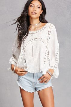 A woven top featuring an allover contrasting semi-sheer embroidered crochet design, a round neckline, and billowy dolman sleeves.<p>- This is an independent brand and not a Forever 21 branded item.</p>