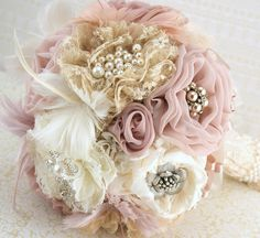 Brooch Bouquet  Vintage-Style in Ivory, Champagne, Blush and Dusty Rose with Feathers, Lace and Pearls. $375.00, via Etsy.