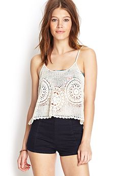 Relaxed good vibes, this flounced cami features an open-knit pattern and adjustable shoulder straps.
