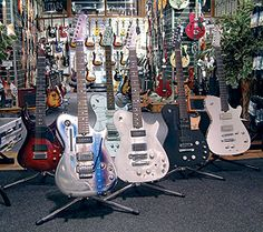 Manson's guitar shop in Exeter, with several Muse guitars at the front.