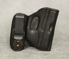 Inside the Waistband Leather Holster for Ruger LC9 with Lasermax laser. Holster comes in black or brown and has ambidextrous capability (left or right hand draw). The clip can be removed and placed on the opposite side of the holster for left hand draw or small of back carry. $54.99 #holster #concealedcarry #IWB #Ruger #RugerLC9 #lasermax Pistol Holster, Leather Holster, Holsters, Ruger Lc9, Kydex, Concealed Carry, Gun, How To Draw Hands, Wallet