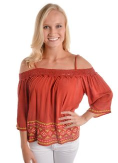 When in Rome Top (burnt orange) – DejaVu  This could work for you Auburn University lovers! Add a Blue bubble necklace and you are set for the game!