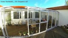 Want to enjoy your terrace all year round - check out retractable patio enclosures! This installation in .