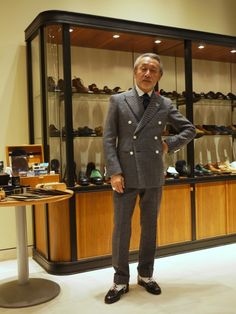 I'm amazed by the shoe collection behind him.
