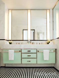 New York City's Mark Hotel Bathroom - black and white striped floors, mint green cabinets, clean lines, and gold accents. Designed by Jacques Grange via House and Home #interiordesign #itsinthedetails