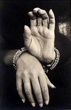 Imogen Cunningham. This photo is successful because of the sepia tint. It really brings out the details in the hands and the bracelets. The dark background also brings out the hands. The hands tell a story and represent progress to me.
