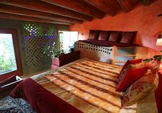 A master bedroom in eco haven Earthship Rentals. Image courtesy of Earthship Rentals.