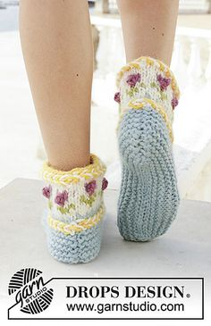 Knitted slippers with Latvian cable and multi-colored Nordic pattern. The piece is worked in DROPS Eskimo.