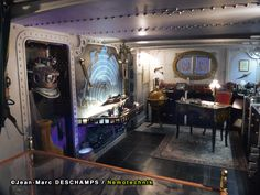 a full sized replica of Captain Nemos Quarters aboard the Nautilus Submarine! Nautilus Submarine, Steampunk Interior, Breakout Boxes, Leagues Under The Sea, Jules Verne, Room Themes, Play Houses, Beach House, Miniatures