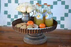 Vintage tart pan and old wooden seed dispenser turned cake stand or lazy susan DIY