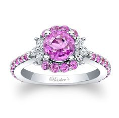 Pink Sapphire Engagement Ring - PC-7930LPSW - This unique white gold pink sapphire and diamond halo engagement ring features a prong set round pink sapphire center encircled with pink sapphires and accented with marquise cut diamonds for a stunning alternative to a traditional halo ring. A slightly squared shank helps to keep the ring from turning on the finger.    Also available in rose, yellow gold, 18k and Platinum.