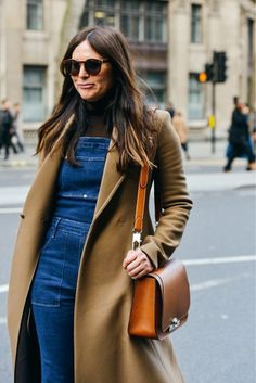 Denim dungarees worn with a camel coat | Image via style.com