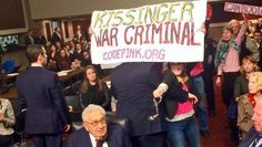 Activists from the antiwar group CodePink attempted to perform a citizen's arrest on former Secretary of State Henry Kissinger when he testified on global security challenges at a Senate Armed Services Committee meeting on Thursday. Kissinger served as secretary of state and national security adviser during the Vietnam War under presidents Richard Nixon and Gerald Ford. Arizona Republican Sen. John McCain lashed out at the protesters and called on the Capitol Hill Police to remove them.