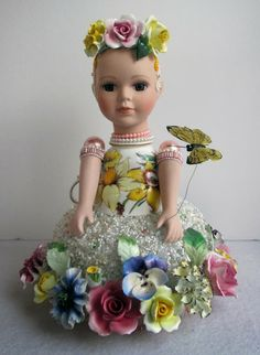 This is an assemblage doll I made, using porcelain flowers, beads a teacup and many other things. Tea with LaVera