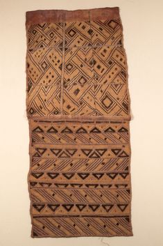 KUBA RAFFIA CLOTH WITH CUT-PILE, KASAI PROVINCE Material: PALM LEAF FIBER Dimensions: L: 129 W: 56 [in CM] Technique: PLAIN WEAVE, CUT-PILE AND STEM STITCH EMBROIDERY Acquisition Year: 1908 [GIFT] Donor: BELGIAN GOVERNMENT