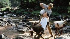 "and the sexiest scene in movie history. Meryl Streep (as Karen Blixen) & Robert Redford (as Denys Finch Hatton) in ""Out of Africa"". The couple are outfitted for a hunting trip with canvas wash basin/stand & folding campaign chair. Robert Redford, Meryl Streep, Karen Blixen, Beau Film, James Baldwin, Sydney Pollack, Travel Movies, Beautiful Film, Beautiful Stories"