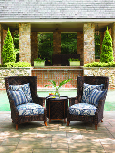 Tommy Bahama - Island Estate Lanai collection. Outdoor wicker wing chairs and tray end table.