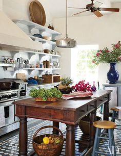 """orlandocustomhomebuilders: """"(via Architectural Digest: Beach Kitchen by Genevieve Faure) The boldly patterned Aguayo tiles in the kitchen of a Dominican Republic estate were locally sourced. The range is by BlueStar. Barn Kitchen, New Kitchen, Kitchen Dining, Kitchen Decor, Wooden Kitchen, Kitchen Ideas, Kitchen Chairs, Kitchen Prep Table, Decorating Kitchen"""