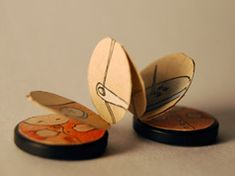 Tell a story within a tiny accordion book with two buttons as covers.