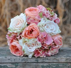 Coral rose, blush rose and pink hydrangea wedding bouquet made of silk roses