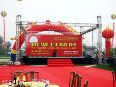 Outdoor events with lighting truss and movable stage. like the style?