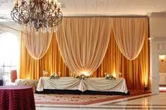Gold Backdrop with Full Valance, elegant curtain design. Elegant Party Decorations, Altar Decorations, Centerpieces, Decoration Hall, Draping Techniques, Reception Backdrop, Pipe And Drape, Head Tables, Elegant Curtains