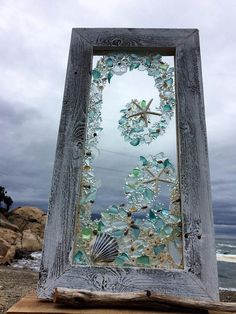 Sea glass and shells on an old window beautiful do it yourself 12 x 24 panel with blue and clear beach glass white star fish solutioingenieria Gallery