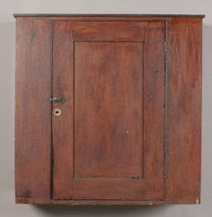 Country hanging cupboard in old red wash