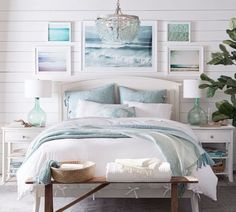 Ocean Hues Beach Bedroom with Sea Glass Chandelier, Ocean Photographs and Glass Lamps. Shop the Look at Pottery Barn. Featured at Beach Bliss Designs:
