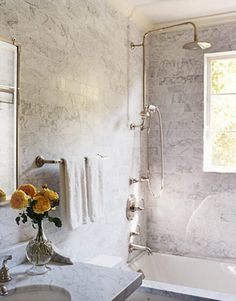 """""""Utilitarian bathrooms were redone with brick-shaped Calacatta marble tiles and fixtures from Smith's Town collection for Kallista, which look as though they've been there forever."""" Cozy Furniture and Decorating Ideas - How to Make a Room Cozy - House Beautiful  #kallista   KALLISTA.com"""