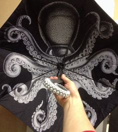 Kraken Rum Umbrella with Octopus image inside and tentacle handle | via Catalogosphere