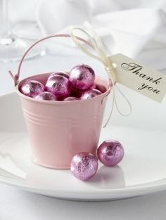 Cute favours...Instead of thank you, you could put your guests names on the label and use them as place settings as well!