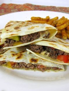 Bacon Cheeseburger Quesadillas - Ground Turkey, Yogurt Spicy Ranch, Turkey Bacon, and whole wheat tortillas and it's kinda healthy!