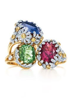 13e89a867 Jean Schlumberger, the renowned Tiffany & Co. Designer, presents a  tourmaline flower ring frosted with detailed round-cut diamonds.
