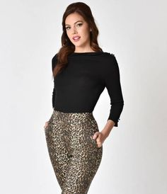 Pure Pin-up perfection, The Celine Top from Voodoo Vixen is a black not-so-basic blouse! Cast in a soft knit construction and formed to hug your curves, topped off with a darling button keyhole back. A modest bateau neckline and slimming three-quarter sle
