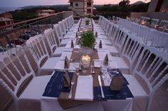Wonderful table set up - wedding table decoration full of candles - white napoleon chairs #weddingsetup #weddingdecoration #whitenapoleon #weddngingreece #weddingreception