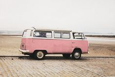 A cute and pink hippie bus