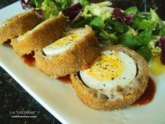 HUEVOS ENVUELTOS: deliciosos albondigones con sorpresa...     Una manera diferente y vistosa de combinar albóndigas y huevos, que seguro ...