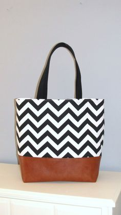 This Extra large tote bag is made from decorator fabric and Faux leather, fully lined with added interfacing giving the bag the ability to keep its shape. There are two twenty five inch straps made from cotton webbing, and double stitched.