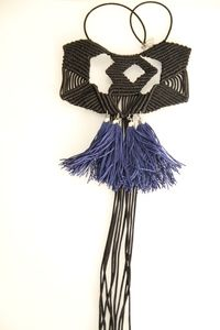 A unique macrame necklace with black cord (4mm), and blue tassels.This macrame pattern is trade mark of Artemis Art Handmade Collection.