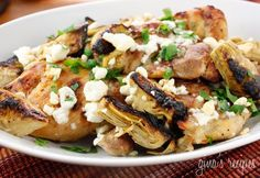 Chicken Thighs with Artichoke Hearts and Feta Cheese - This is a quick Greek inspired chicken dish and a great way to make boneless chicken thighs.