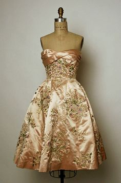A sublimely lovely silk peach, heavily beaded evening dress from 1956. #vintage #fashion #dress #peach #1950s