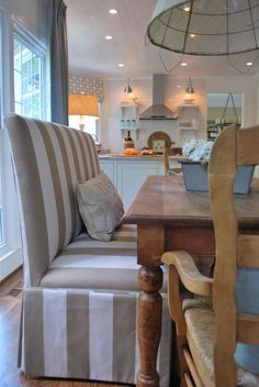 Sunbrella fabrics on a banquette make for a comfortable space where families can linger and a practical place to keep clean!