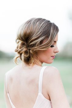 messy bun bridesmaid hair idea