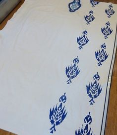 DIy drop cloth curtains. Ya know, I've made pillows with this, and painted brands and such, but, I never thought of doing curtains, and painting something on them! Super!